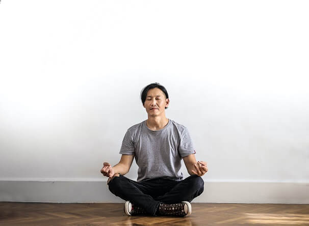 Man meditating before going to his dental appointment
