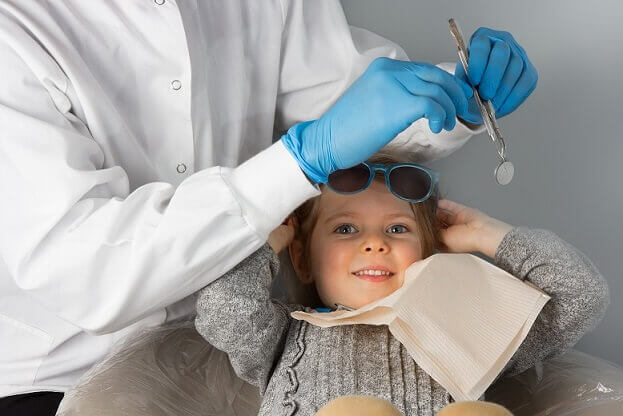 young girl at first dentist visit